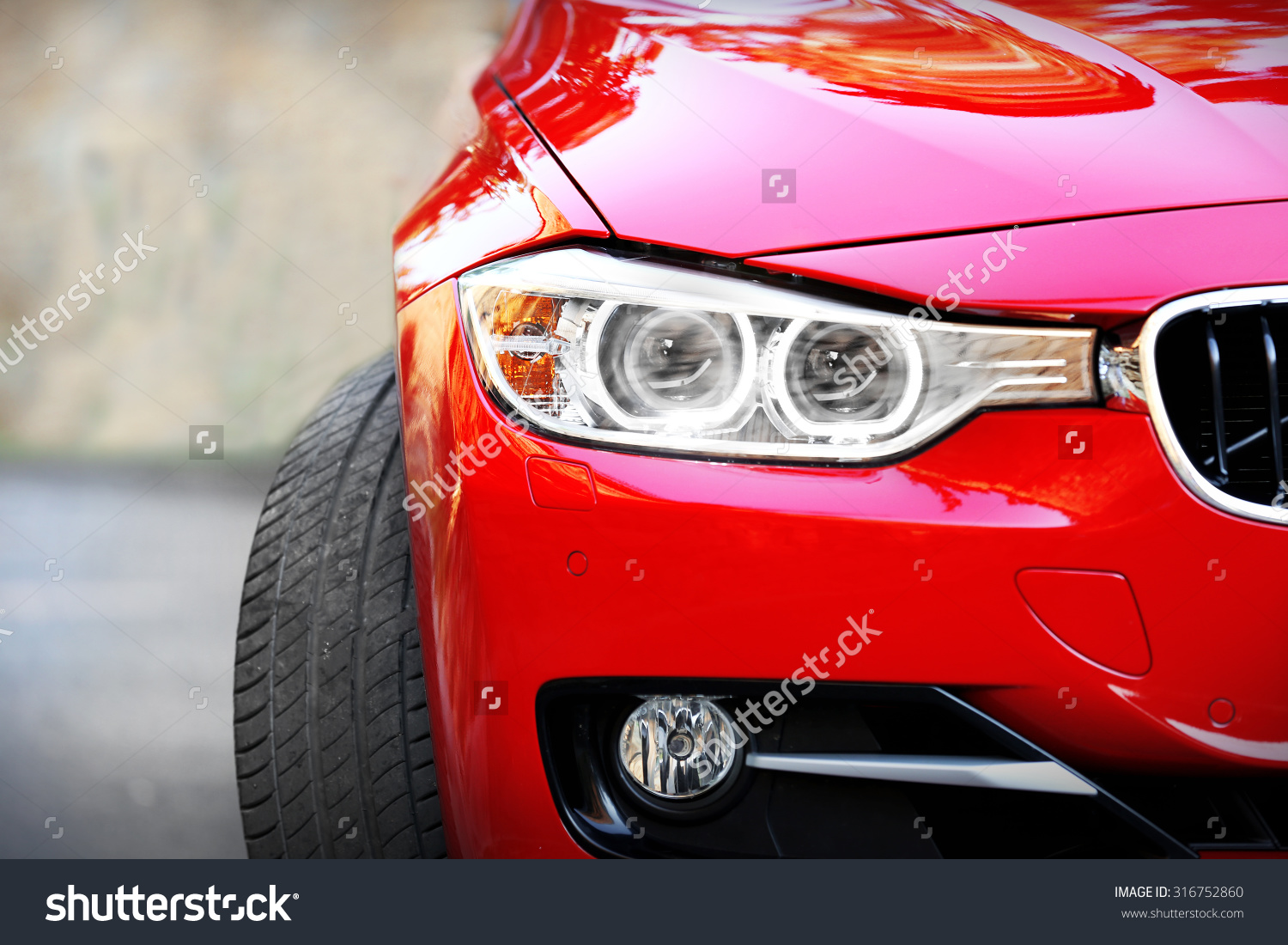 stock photo red car outdoors 3167528601